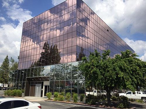 Building Wrap with Exterior Bronze Window Tint